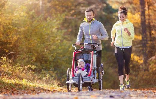 family running with stroller on paths around Seattle and the Eastside
