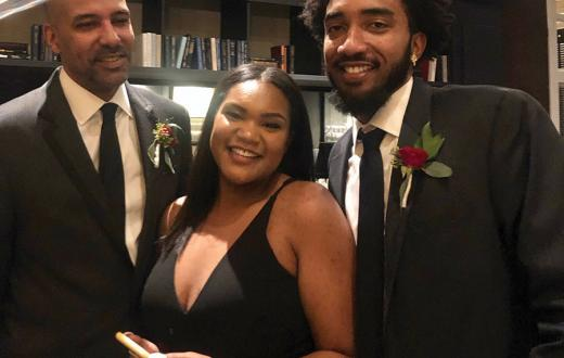 Leila Abe celebrates with her father and brother