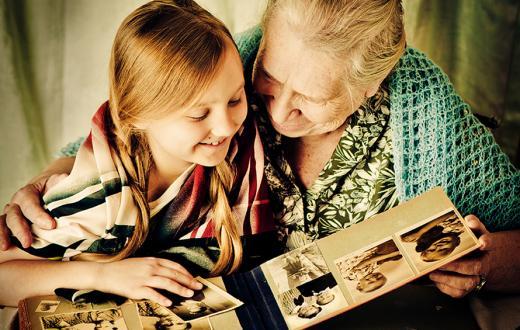 granddaughter and grandmother looking at photos