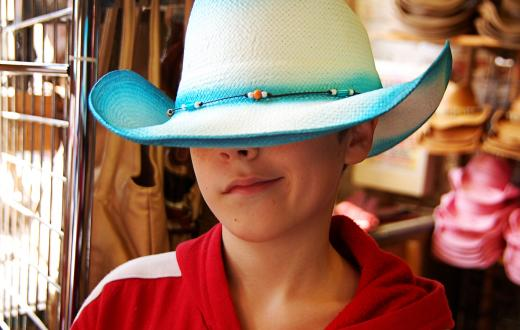 Boy wearing a cowboy hat
