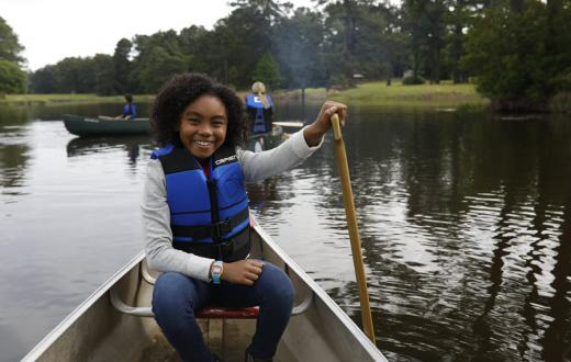 Young Seattle Scouts BSA participant enjoying canoeing