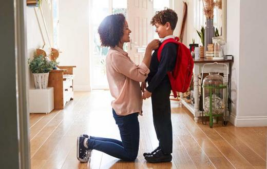 mom getting son ready for school