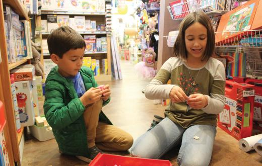 kids trying out Plus-Plus construction pieces at Teaching Toys in Tacoma's Proctor District