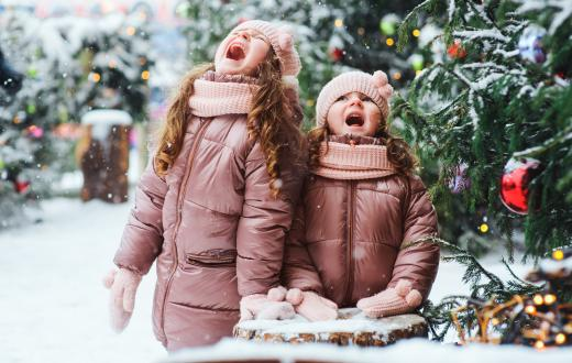 Girls-in-snow-by-Christmas-tree-holiday-fun-budget-cheap-free-kids-families-tacoma-south-sound