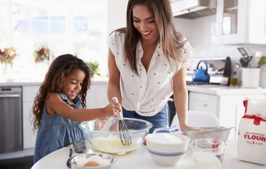 Mom-and-daughter-baking-in-home-kitchen-ways-to-help-kids-value-cultural-diversity