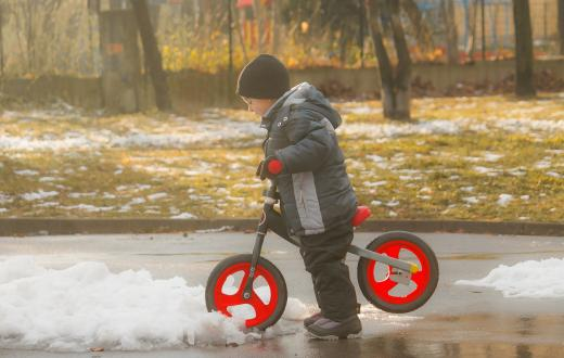 Boy-on-bike-in-melting-snow-Seattle-best-weekend-activities-events-kids-families-kids-seattle-tacoma-bellevue-eastside-puget-sound