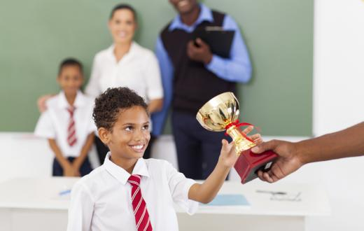 boy being handed a trophy