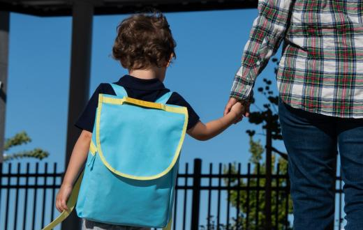 little boy with backpack going back to preschool