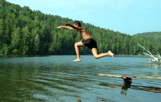 boy jumping in a lake swimming northwest summer fun best activities kids seattle tacoma bellevue eastside puget sound families