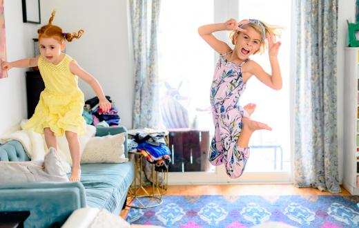 girls jumping and dancing on furnture active at-home recess ideas for remote learning