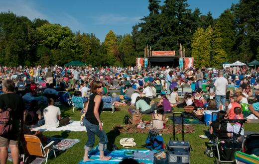 Concert goers enjoy a ZooTunes outdoor concert at Seattle's Woodland Park Zoo in a previous year
