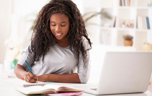 Teen girl writing essay