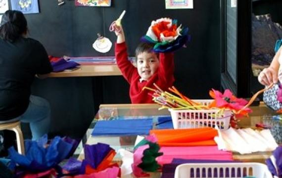 Joseph Grygiel, 5, of Seattle, makes crepe paper flowers in the Tacoma Art Museum studio