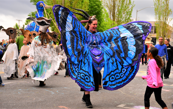Butterfly costumed participant in the Procession of the Species