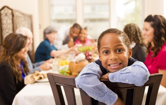 Boy-at-restaurant-Thanksgiving-dinner-families-seattle-bellevue-tacoma-eastside
