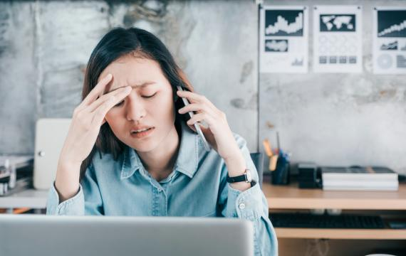 Woman stressed at computer