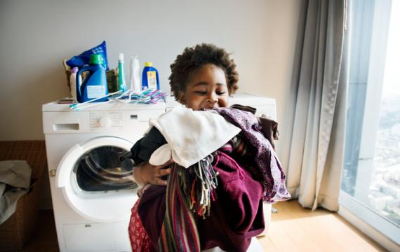 Child doing laundry