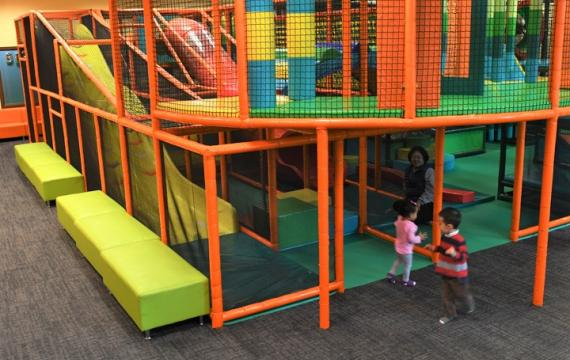 Kids playing inside at Safari play space