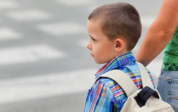 Young boy going to school