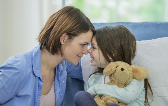 Mom and kid with teddy bear