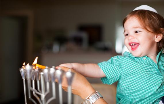 Child celebrating Hannukkah