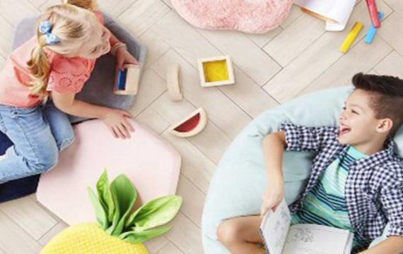 Kids lounging on Pillowfort sensory sensitive furniture