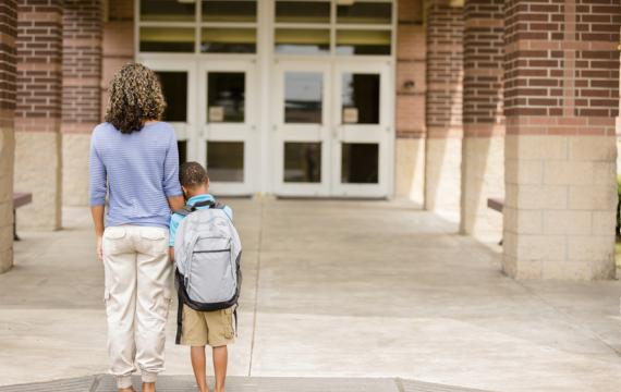 anxious mother and son on the first day of school