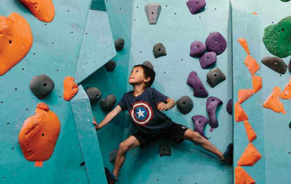 little boy rock climbing