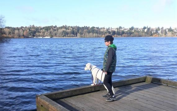 boys-and-dog-on-dock-at-green-lake-best-seattle-weekend-activities-familis-kids-bellevue-tacoma-eastside