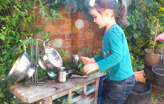mud kitchen in the backyard