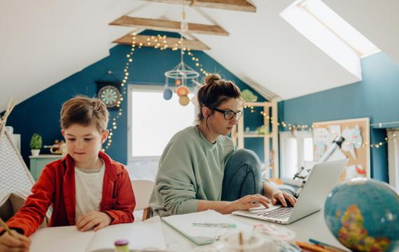 kid-working-with-parent-at-home