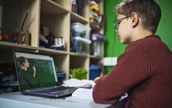 Young student attends school by video conference