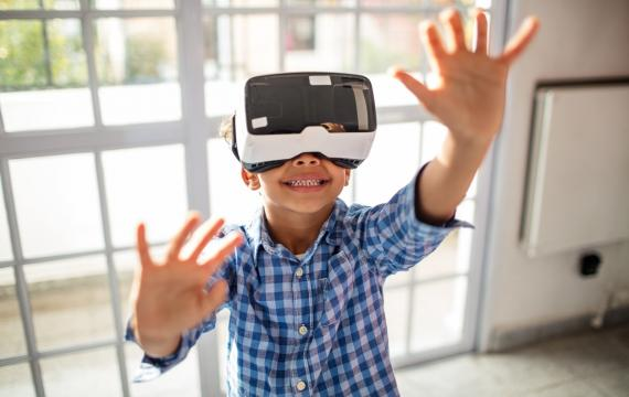 Young boy wearing a virtual reality headset