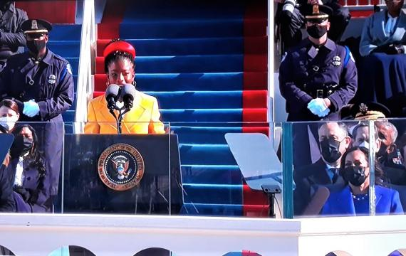 Amanda Gorman first U.S. youth poet laureate wearing yellow coat delivers inauguration poem as first female vice president kamala harris looks on on January 20, 2021