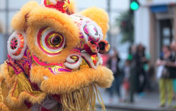 Close-up of yellow lion head during traditional Chinese lion dance lunar new year celebrations Seattle families 2021