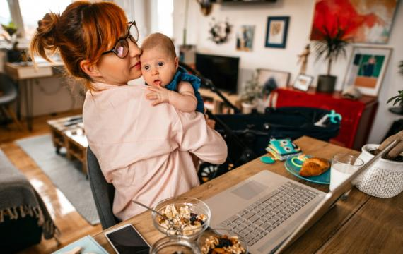 Parent-with-baby-on-laptop