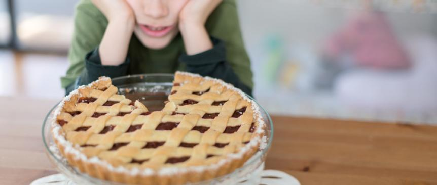 Kid looking at pie